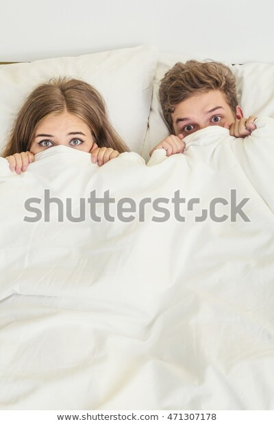 Boy and Girl In Bedroom Surprised Teens Boy Girl White Bed Stock Edit now