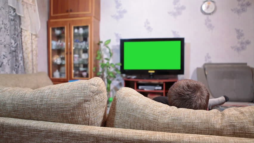 Comfortable Living Roomfor Movie Watching Young Boy Sitting sofa and Watching Green Screen Tv In