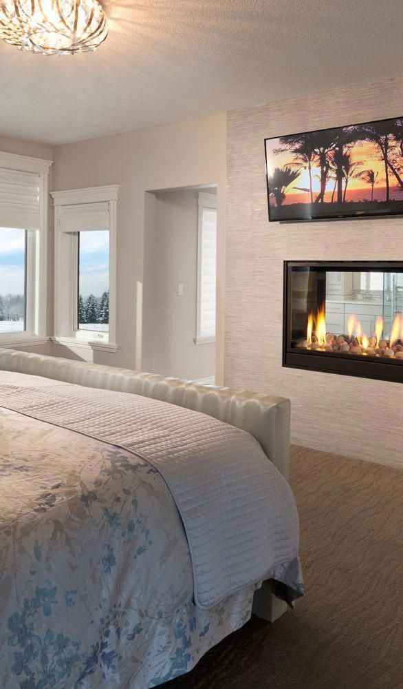 Master Bedroom with Fireplace Luxury Master Bedroom with A 2 Way Gas Fireplace and Flat