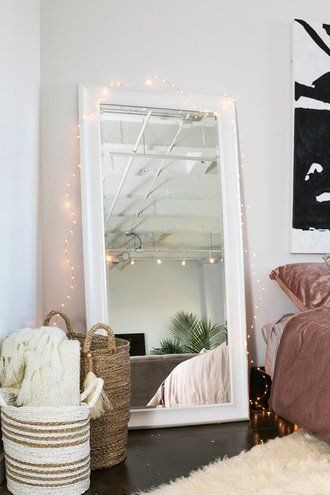 Mirrors for Bedroom Walls A Large Mirror Leaning Against A Bedroom Wall with Woven